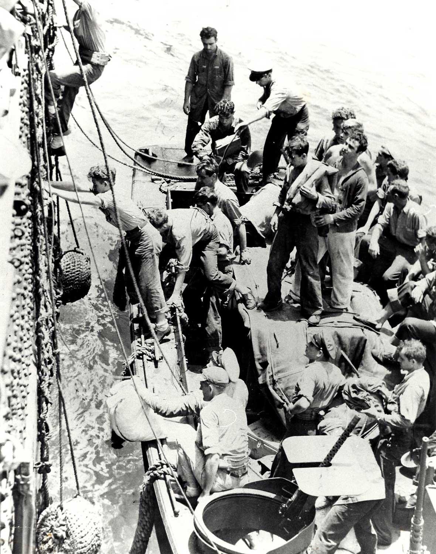 DD-343, APD-24 Survivors taken onto the USS INDIANA - 1